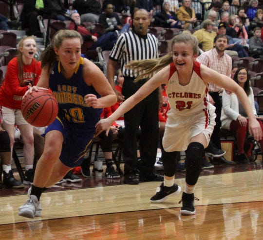Mountain Home senior Payton Huskey drives to the basket against Russellville on Friday evening.
