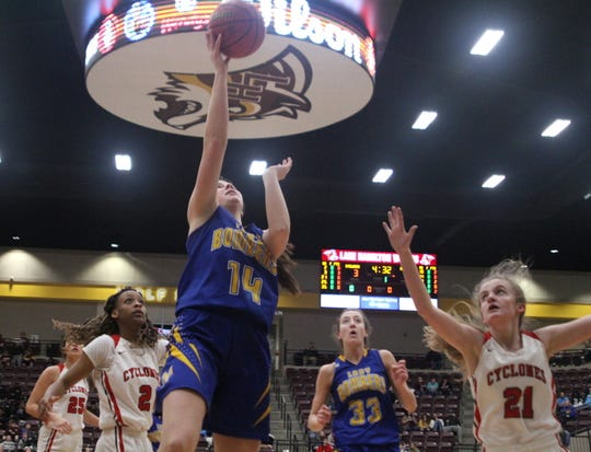 Mountain Home's Kyra Pinn goes up for two against Russellville in the Class 5A State quarterfinals Friday at Lake Hamilton.