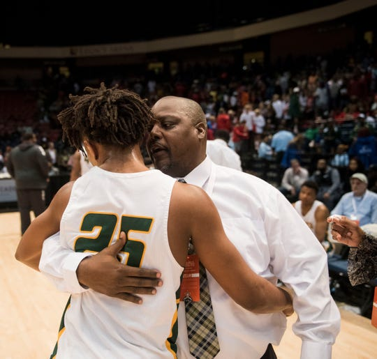 Carver head coach James Jackson hugs Juwon Gaston (25) after losing the Class 6A state championship at Legacy Arena in Birmingham, Ala., on Saturday, March 2, 2019. Pinson Valley defeated Carver 58-44.