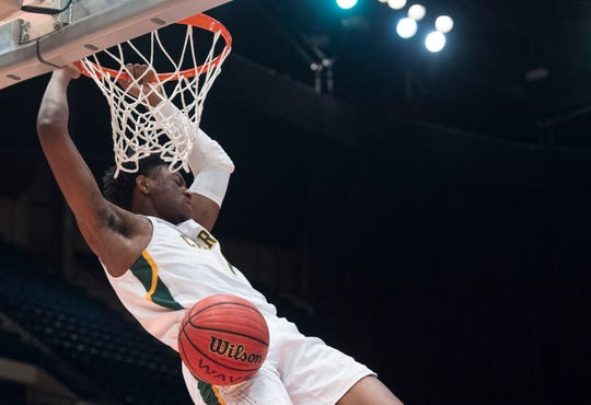 Carver's Jaykwon Walton (1) dunks the ball during the Class 6A state championship at Legacy Arena in Birmingham, Ala., on Saturday, March 2, 2019. Carver leads Pinson Valley 28-27 at halftime.