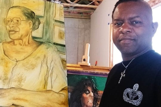 MSgt. Columbus Cook, who has brain cancer, in his home art studio that is being created so he can be a full-time artist.