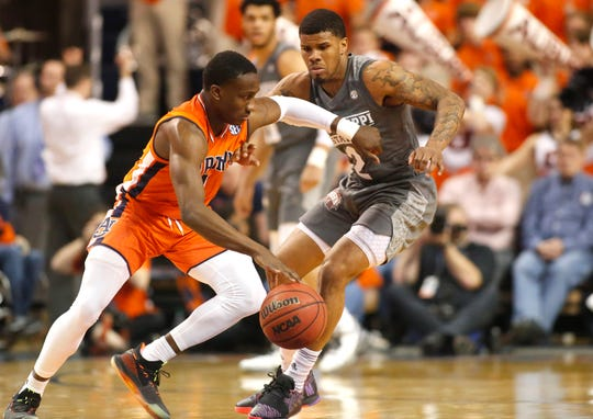 Auburn guard Jared Harper (1) is defended by Mississippi State guard Lamar Peters (2) on Saturday, March 2, 2019.