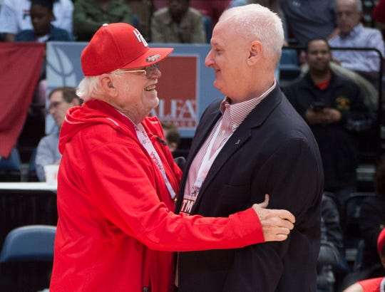 Hazel Green coach Tim Miller, right, hugs his dad, Doug, after winning the Class 6A state championship at Legacy Arena in Birmingham, Ala., on Saturday, March 2, 2019.