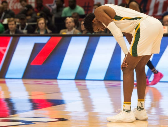Carver's Jaykwon Walton (1) reacts after making a bad pass during the Class 6A state championship at Legacy Arena in Birmingham, Ala., on Saturday, March 2, 2019. Pinson Valley defeated Carver 58-44.