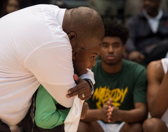 Carver head coach James Jackson hugs his son, James III, during the Class 6A state championship at Legacy Arena in Birmingham, Ala., on Saturday, March 2, 2019. Pinson Valley defeated Carver 58-44.