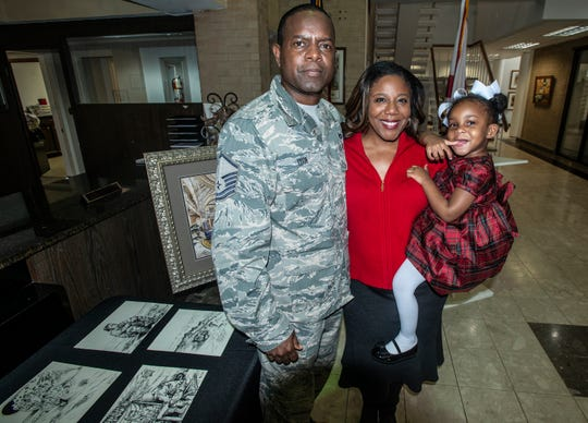 MSgt. Columbus Cook with his wife, Val Porter Cook, and their 2-year-old daughter, Summer, during an art donation at Wetumpka City Hall on Friday, Feb. 22, 2019.