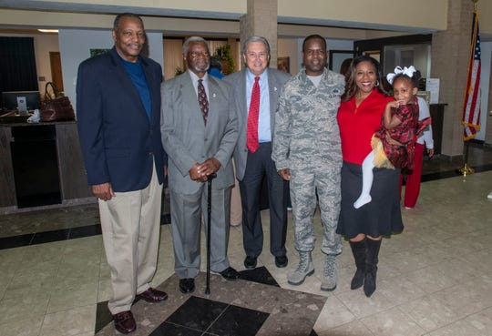 From left, Winfred Wise, City Councilman Lewis E. Washington Sr, Mayor Jerry Willis, MSgt. Columbus Cook, Val Porter Cook, and Summer Cook at Wetumpka City Hall. Columbus Cook donated several pieces of his artwork to Wetumpka on Friday, Feb. 22, 2019.