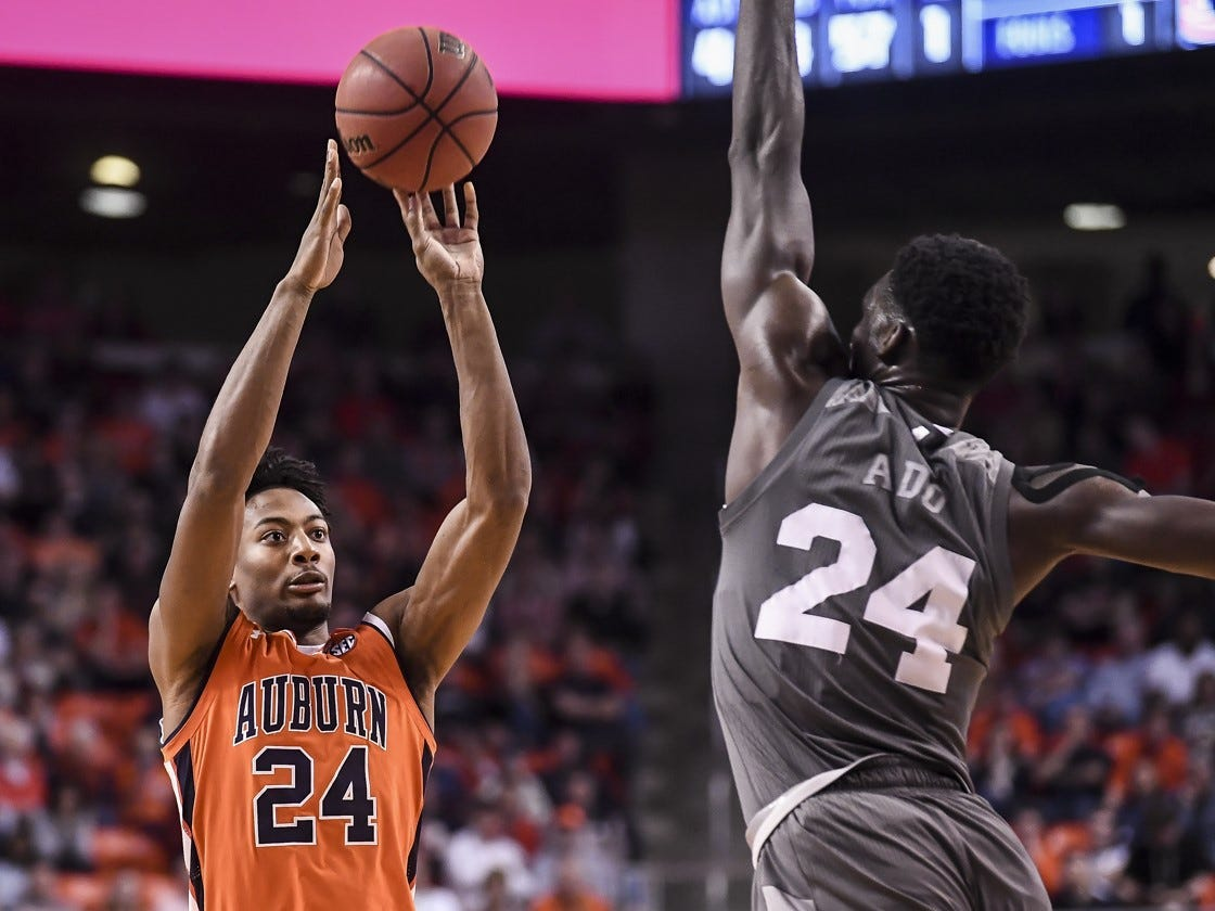 Auburn's Anfernee McLemore attempts a shot over Mississippi State's Abdul Ado on Saturday, March 2, 2019.