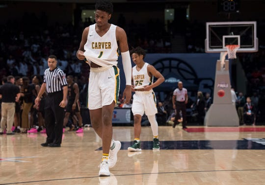 Carver's Jaykwon Walton (1) and Carver's Juwon Gaston (25) walk of the court in disappointment during a late timeout during the Class 6A state championship at Legacy Arena in Birmingham, Ala., on Saturday, March 2, 2019. Pinson Valley defeated Carver 58-44.
