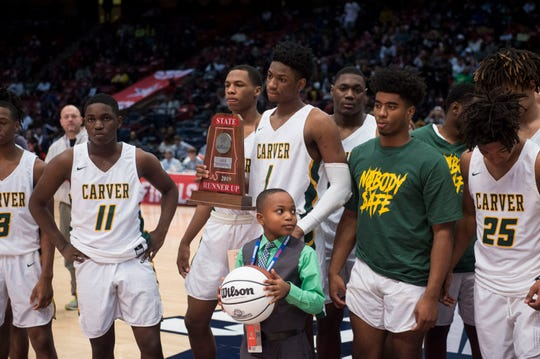 Carver players accept their runner up trophy during the Class 6A state championship at Legacy Arena in Birmingham, Ala., on Saturday, March 2, 2019. Pinson Valley defeated Carver 58-44.