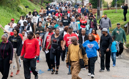 Hundreds take part in a Prayer Walk in the Washington Park Neighborhood in Montgomery, Ala., on Saturday March 2, 2019.