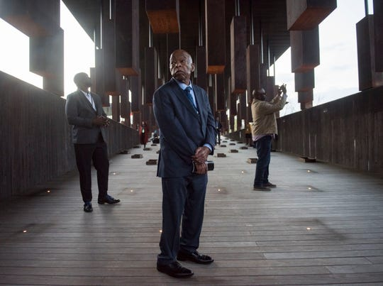 U.S. Rep. John Lewis walks through the monuments during a congressional delegation visit at the EJI National Memorial in Montgomery, Ala., on Friday, March 1, 2019.