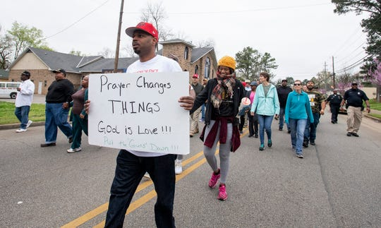 Jay Mayes joined hundreds in a Prayer Walk in the Washington Park Neighborhood in Montgomery, Ala., on Saturday March 2, 2019.