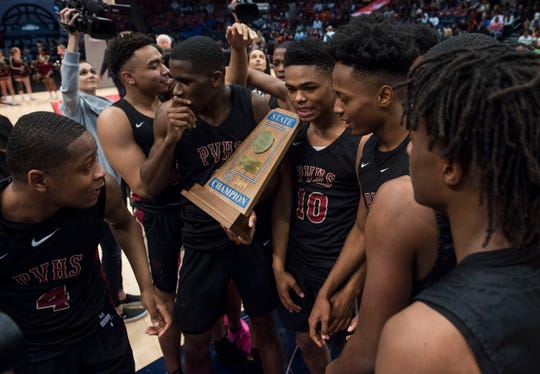 Pinson Valley players celebrate with their trophy during the Class 6A state championship at Legacy Arena in Birmingham, Ala., on Saturday, March 2, 2019. Pinson Valley defeated Carver 58-44.