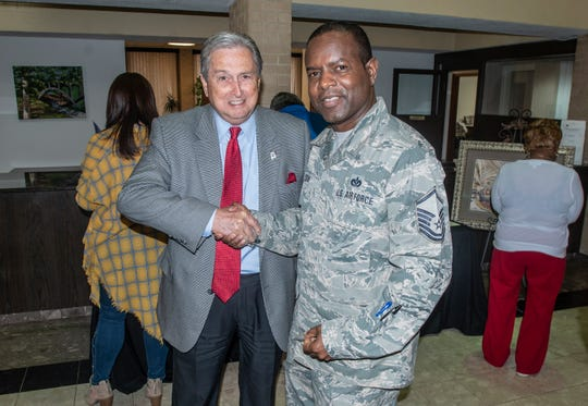 Wetumpka Mayor Jerry Willis shakes hands with MSgt. Columbus Cook, who donated several pieces of his artwork to Wetumpka on Friday, Feb. 22, 2019.