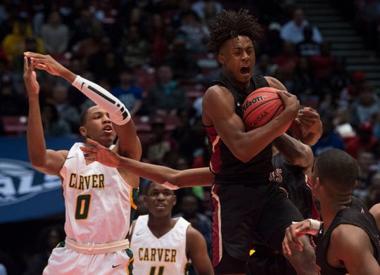 Pinson Valley's Kool-Aid Mckinstry (1) grabs a rebound during the Class 6A state championship at Legacy Arena in Birmingham, Ala., on Saturday, March 2, 2019. Carver leads Pinson Valley 28-27 at halftime.
