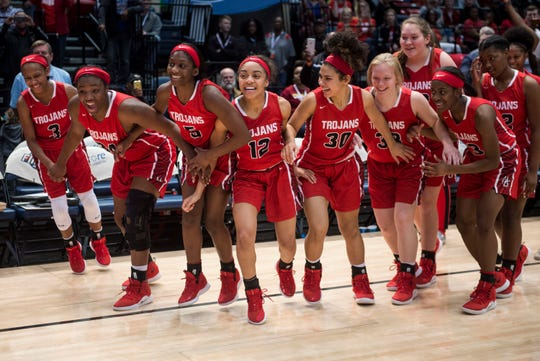 Hazel Green's team runs to get their trophy after winning the Class 6A state championship at Legacy Arena in Birmingham, Ala., on Saturday, March 2, 2019.