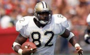 Former New Orleans Saints tight end Irv Smith (82) played seven seasons in the NFL between 1993-99 before retiring. His son, Irv Smith Jr., is now following in his footsteps as a NFL prospect after a record-breaking three-year career at Alabama.