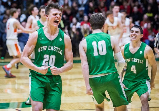 FILE -- New Castle's William Grieser (left) and Cole McDaniel (right) celebrate after beating Hamilton Heights in their sectional game at New Castle High School Friday, March 1, 2019.