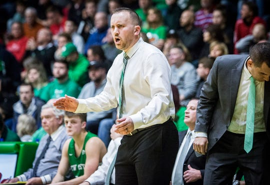FILE -- New Castle's Daniel Cox coaches against Hamilton Heights during their sectional game at New Castle High School Friday, March 1, 2019.