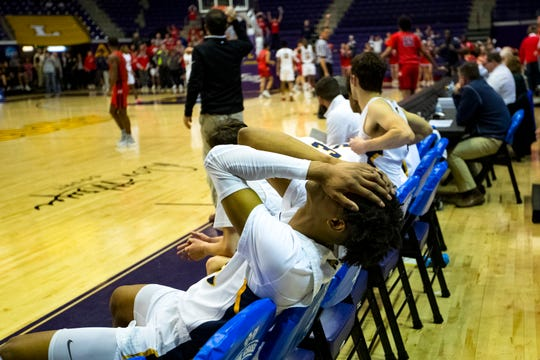 Webb's Keon Johnson (23) covers his face as Webb loses possession of the ball while down by three with 6.2 seconds left on the clock, during Webb's game against Tipton-Rosemark in the semifinal round of the TSSAA Division II Class A State Championships at Lipscomb University's Allen Arena in Nashville on Friday, March 1, 2019.
