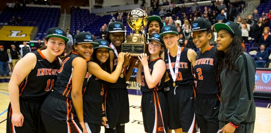 Ensworth's players raise the 2019 State Championship trophy after Brentwood Academy's game against Ensworth in the finals of the TSSAA Division II Class AA State Championships at Lipscomb University's Allen Arena in Nashville on Saturday, March 2, 2019.
