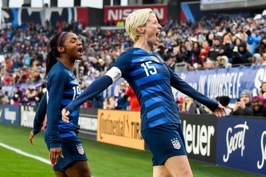13e38bd84 USA midfielder Megan Rapinoe (15) celebrates her goal with USA forward  Crystal Dunn (