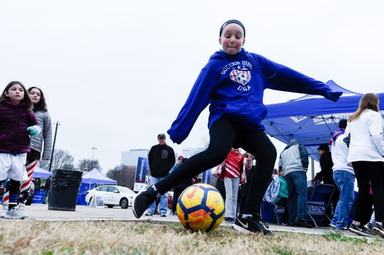 Lauren Kutoloski, 10, kicks the ball before the 2019 SheBelieves Cup match at Nissan Stadium Saturday, March 2, 2019 in Nashville, Tenn.