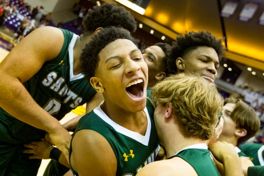 Briarcrest Christian's Kennedy Chandler (1) celebrates with his teammates after Brentwood Academy's game against Briarcrest Christian in the finals of the TSSAA Division II Class AA State Championships at Lipscomb University's Allen Arena in Nashville on Saturday, March 2, 2019.