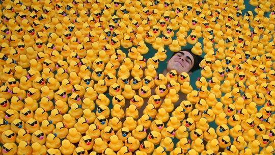 Sun-N-Fun Lagoon life guard Wyatt Focht has fun with his fellow life guards before the start of the Great Naples Duck Race, Saturday, Feb. 2, 2019, at the Sun-N-Fun Lagoon in East Naples.