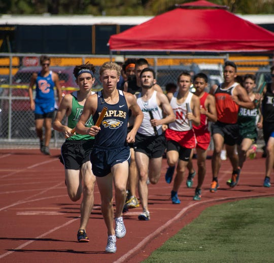 Naples High School's Brady Gibson leads the pack in a relay in the 55th Eagle Invitational track and field meet at Naples High School on Saturday.