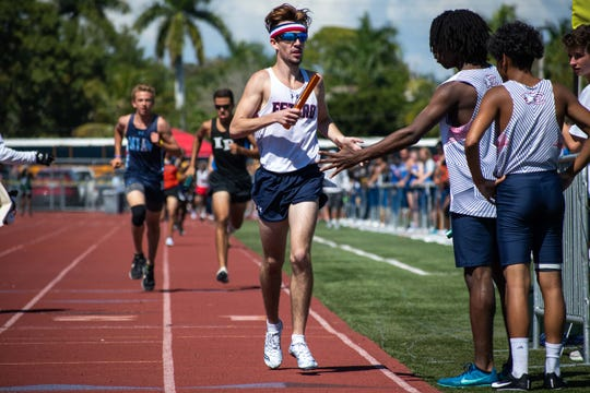 Estero's Hugh Brittenham competes in a relay in the 55th Eagle Invitational track and field meet at Naples High School on Saturday.