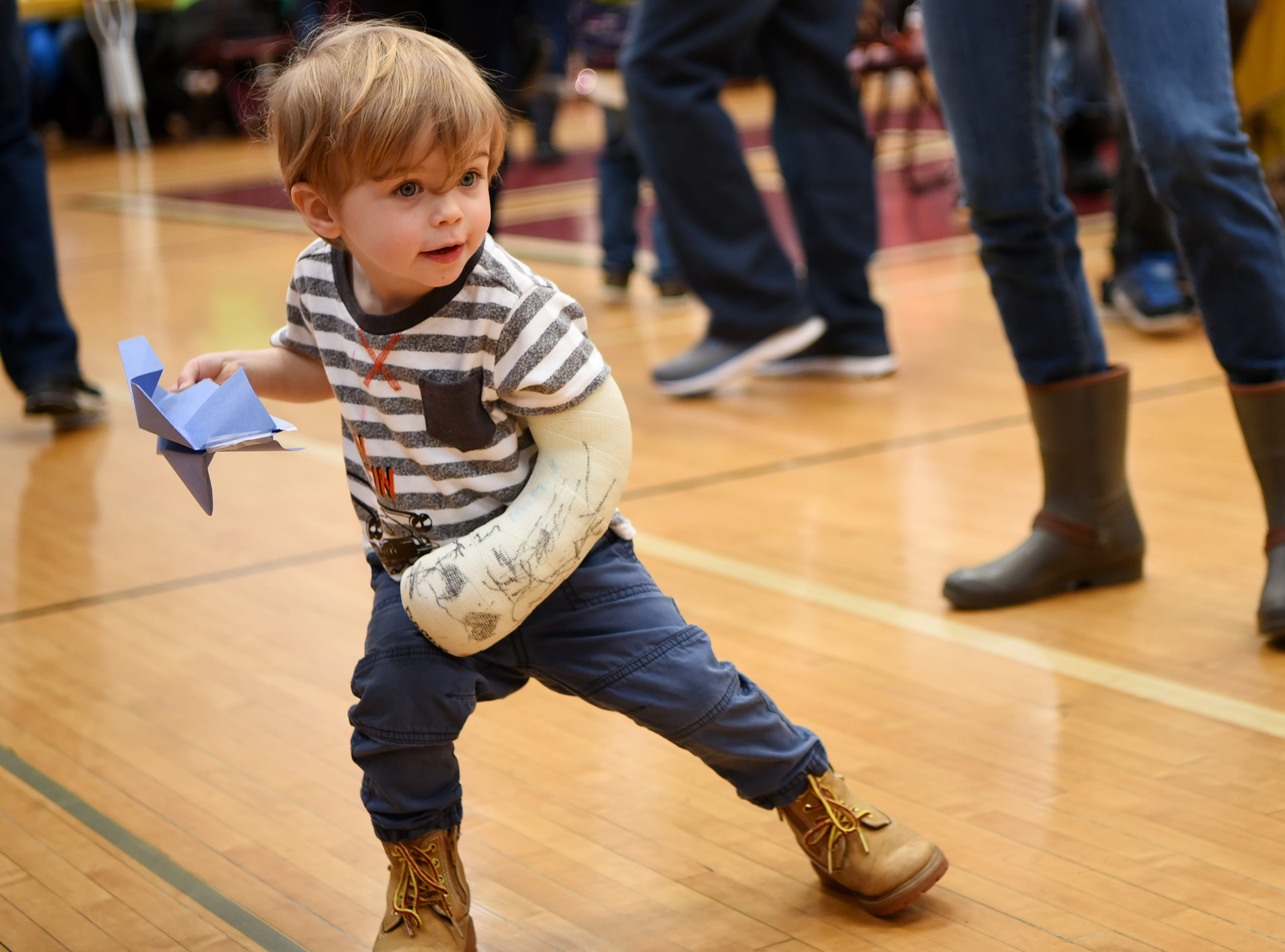Hunter Pomo, 2, winds up to launch his paper airplane. This is one of many activities during Super Science Saturday held at Ridgewood High School in Ridgewood on Saturday March 2, 2019.