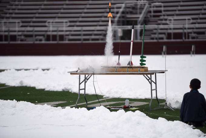 A boy watches from a safe distance as a rocket launches during Super Science Saturday held at Ridgewood High School in Ridgewood on Saturday March 2, 2019.