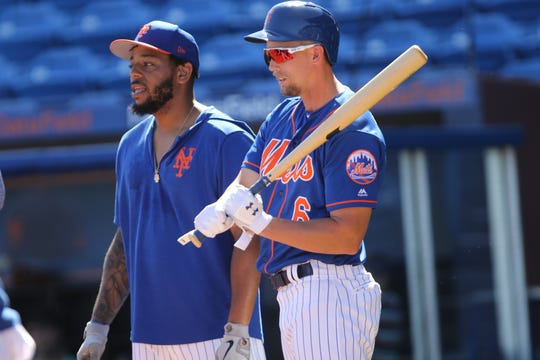 Dom Smith and Jeff McNeil, are shown during batting practice, Saturday, March 2, 2019.