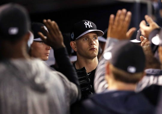 Mar 1, 2019; Tampa, FL, USA; New York Yankees starting pitcher James Paxton (65) is congratulated by teammates in the dugout as he is taken out duding the third inning against the Baltimore Orioles at George M. Steinbrenner Field.