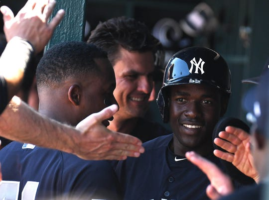 Mar 2, 2019; Bradenton, FL, USA; New York Yankees outfielder Estevan Florial (92) celebrates scoring a run in the second inning of the spring training game against the Pittsburgh Pirates at LECOM Park.
