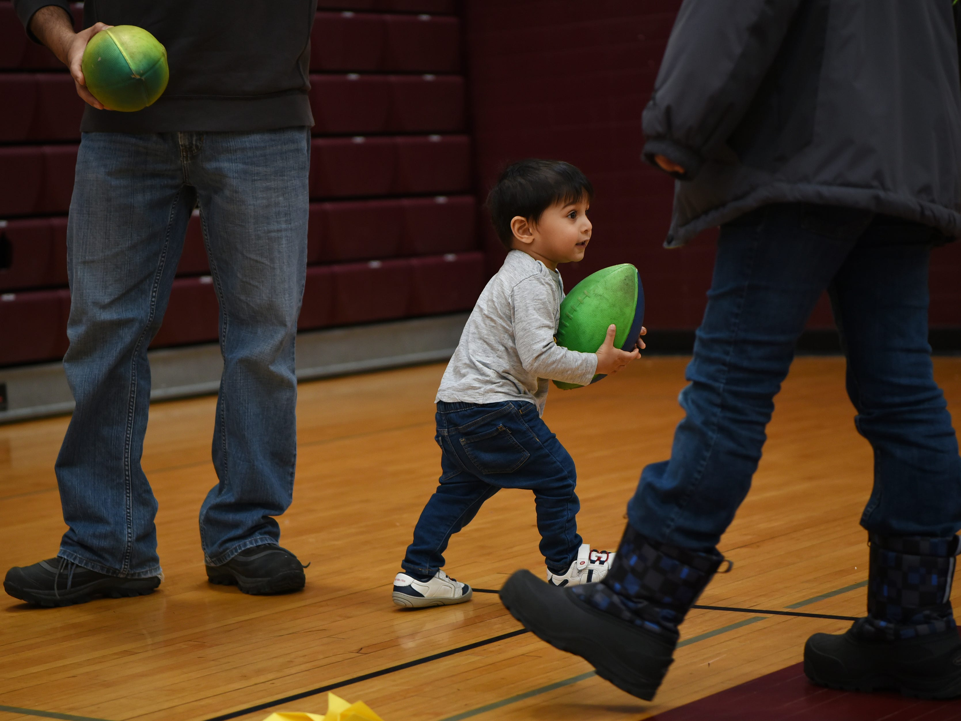 Riaan Shah, 18 months, plays with a footbal provided by Professor Tennis at the Super Science Saturday held at Ridgewood High School in Ridgewood on Saturday March 2, 2019.