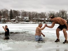 People brave the cold and snow at Lindy Lake polar bear plunge in West Milford