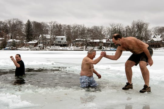 Polar bear plunge at Lindy Lake in West Milford on Saturday, March 2, 2019. (from right) Eric Bos, George DeGraaf and Tim Lautz.