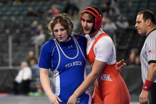 Erin Emery of Teaneck, left, and Maria Taseva of Elmwood Park hug after Emery wins the 185-pound semifinal on Day 2 of the NJSIAA state wrestling tournament on Friday, March 1, 2019, in Atlantic City.