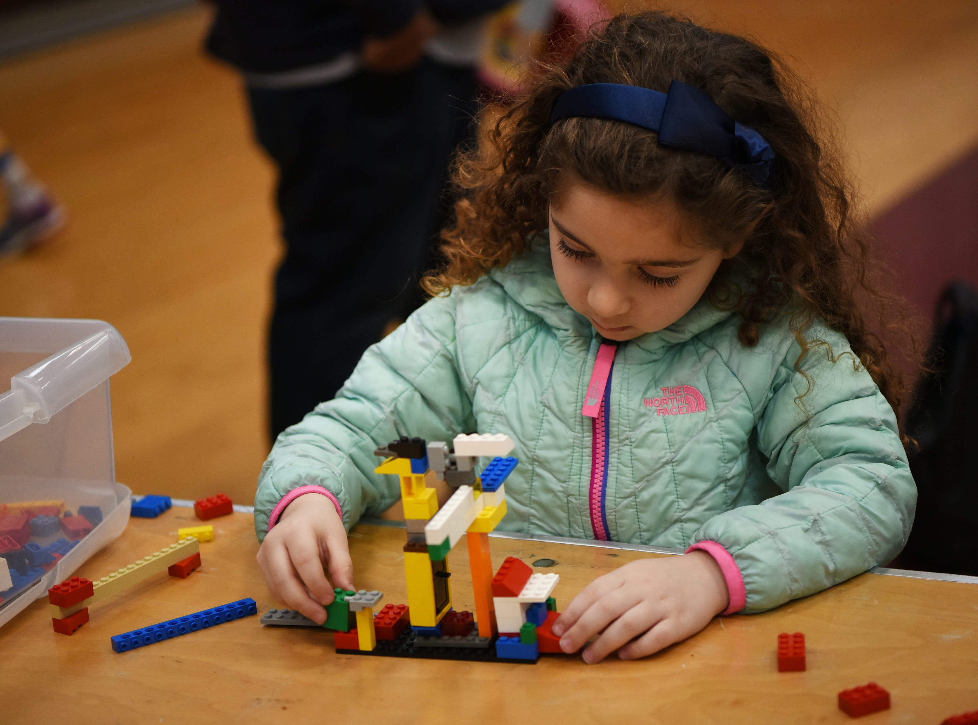 Genevieve Tavani, 4 plays with LEGO blocks. This is one of many activities during Super Science Saturday held at Ridgewood High School in Ridgewood on Saturday March 2, 2019.