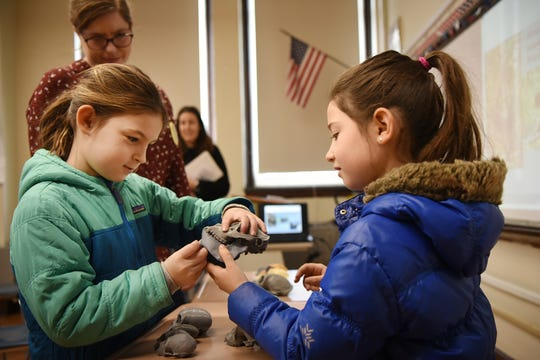 Sydney Gibin and Kiera Acunto, both seven years old, look at primate skulls during a lecture by Lauren B. Halenar-Price, PHD and former Ridgewood Student. This is one of many activities during Super Science Saturday held at Ridgewood High School in Ridgewood on Saturday March 2, 2019.