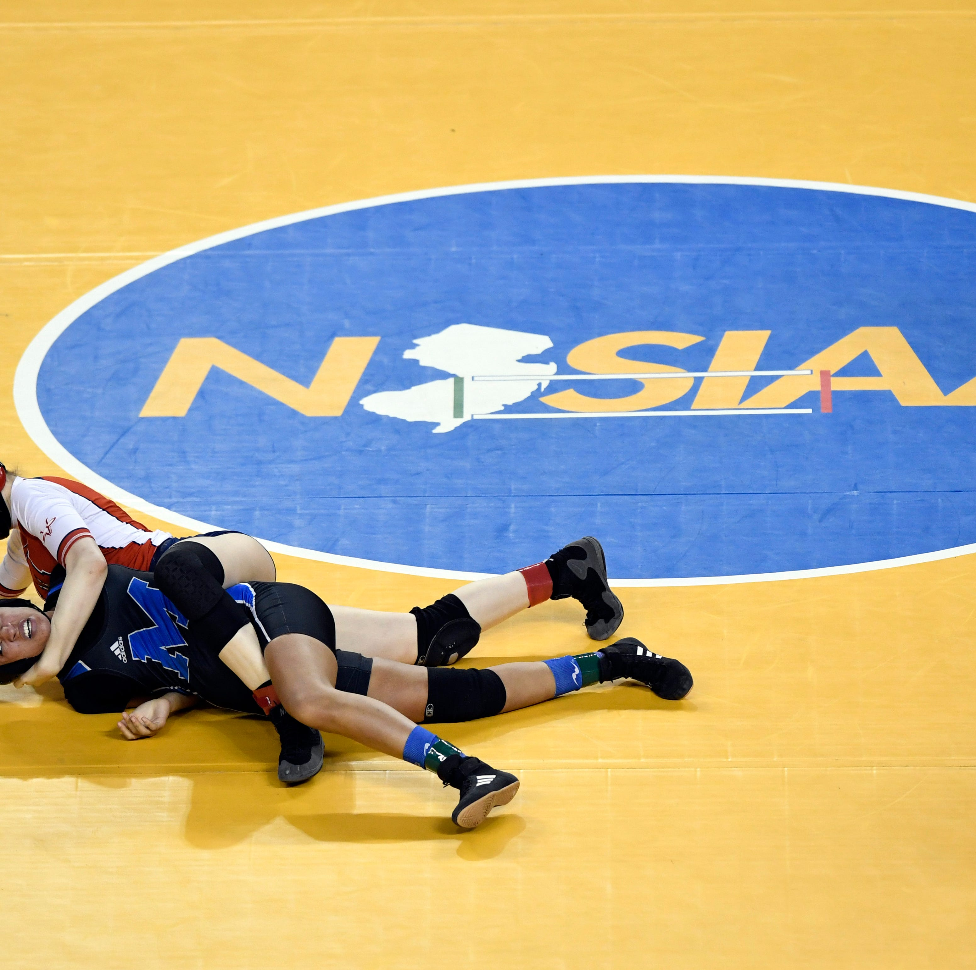 Jesse Johnson of Manalapan (red) attempts to pin Jaala Williams of Montclair in the 136-pound final match of the NJSIAA state wrestling tournament on Saturday, March 2, 2019, in Atlantic City.