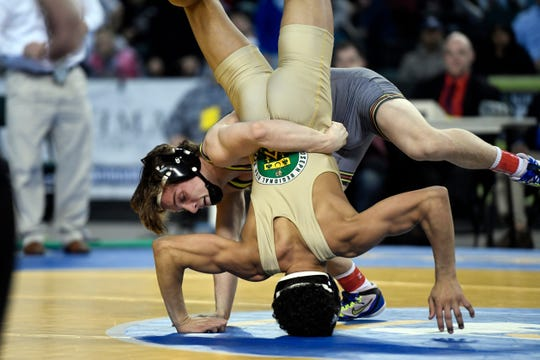Robert Howard of Bergen Catholic and Sammy Alvarez of St. Joseph Regional compete in the 126-pound final match of the NJSIAA state wrestling tournament on Saturday, March 2, 2019, in Atlantic City.