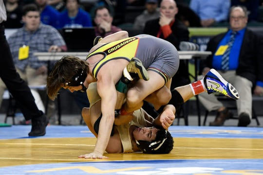 Robert Howard of Bergen Catholic (top) and Sammy Alvarez of St. Joseph Regional compete in the 126-pound final match of the NJSIAA state wrestling tournament on Saturday, March 2, 2019, in Atlantic City.