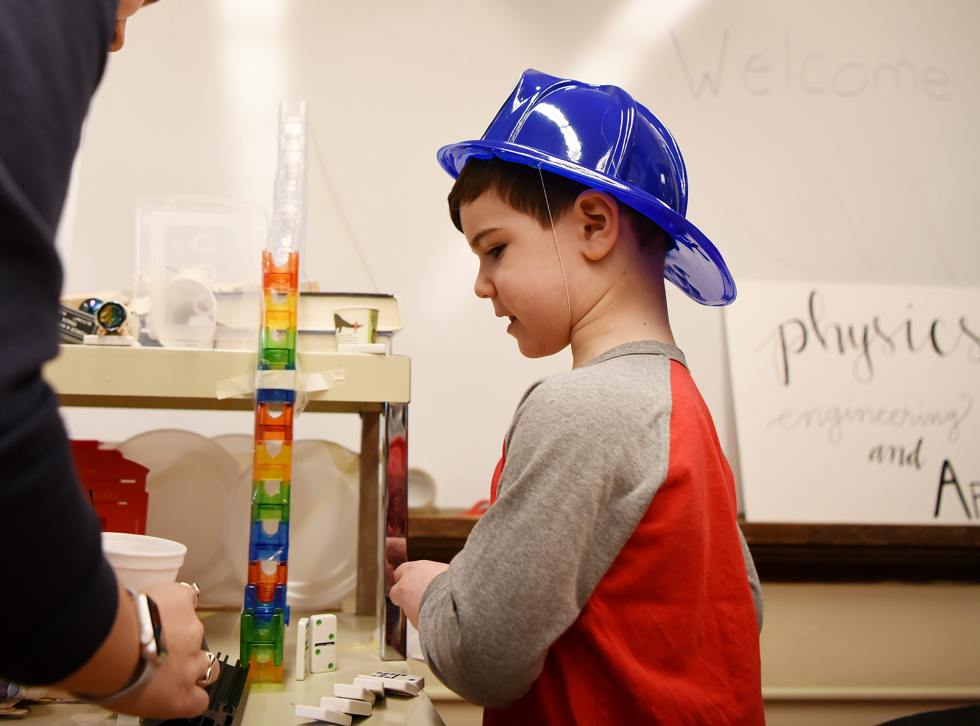Matthew Bordman, 5, helps set up a Rube Goldberg machine during Super Science Saturday held at Ridgewood High School in Ridgewood on Saturday March 2, 2019.