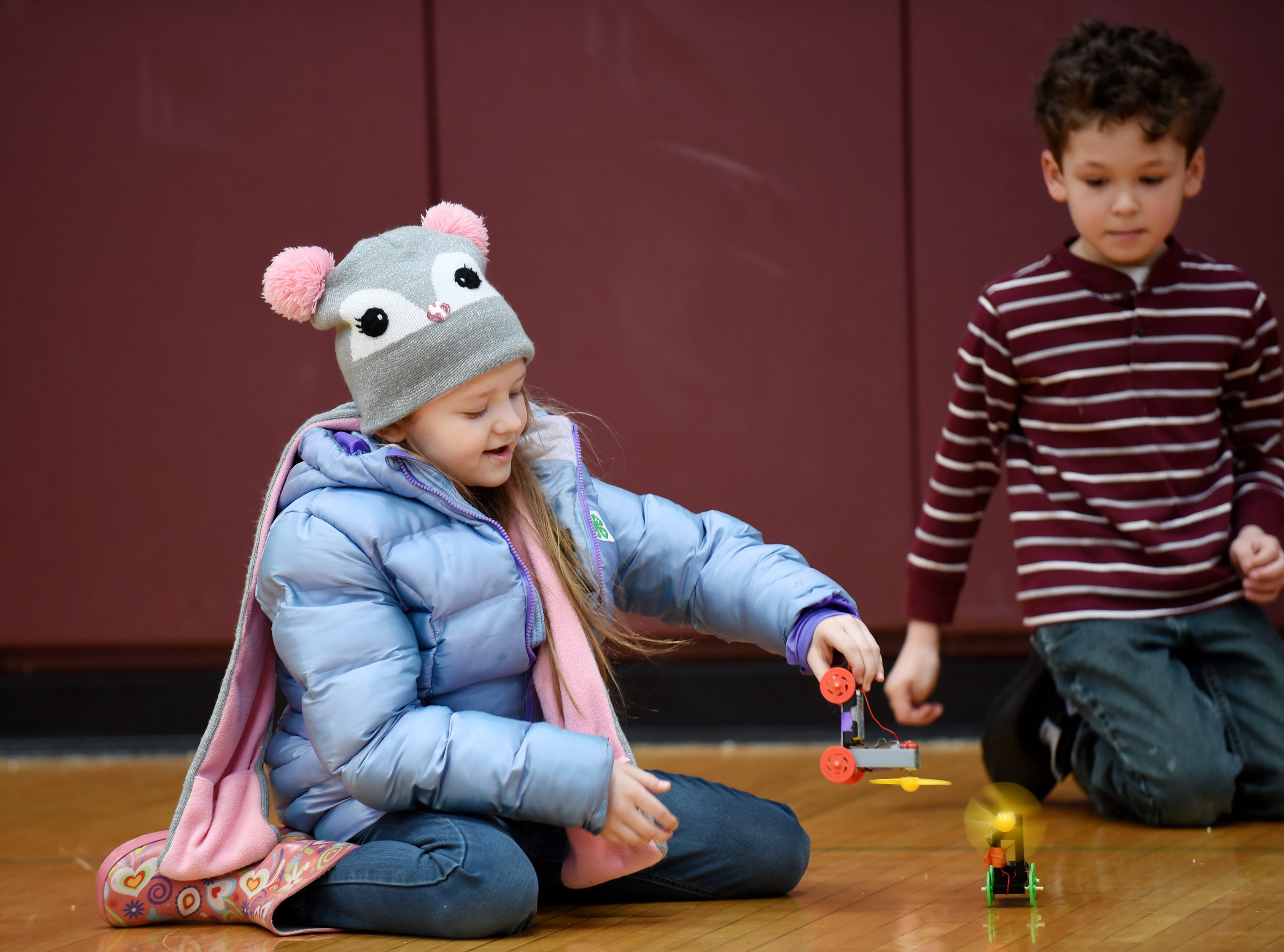 Faith Stanchek, 9 and Jason Muzio, 7 play with the wind-powered electeric cars they built. This is one of many activities during Super Science Saturday held at Ridgewood High School in Ridgewood on Saturday March 2, 2019.