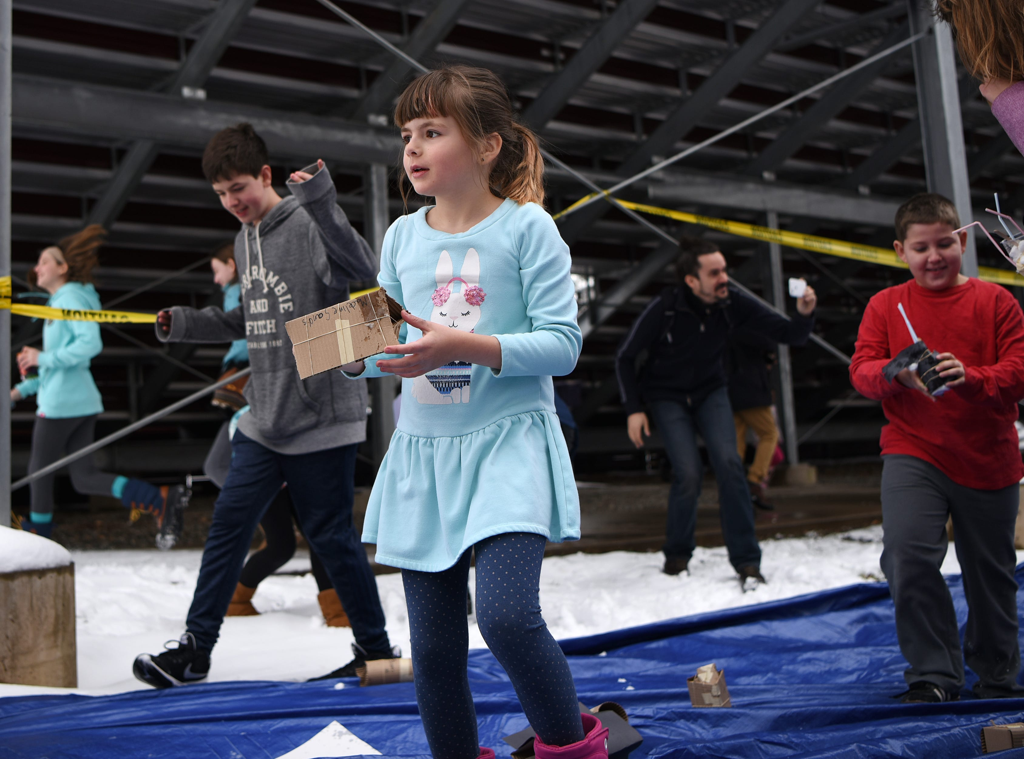 Madeline Sands, 8, checks to see if her egg landed safely during the Egg Drop. Children must create a device that will prevent their egg from breaking from a 30 foot drop. This is one of many hands on activities during Super Science Saturday held at Ridgewood High School in Ridgewood on Saturday March 2, 2019.