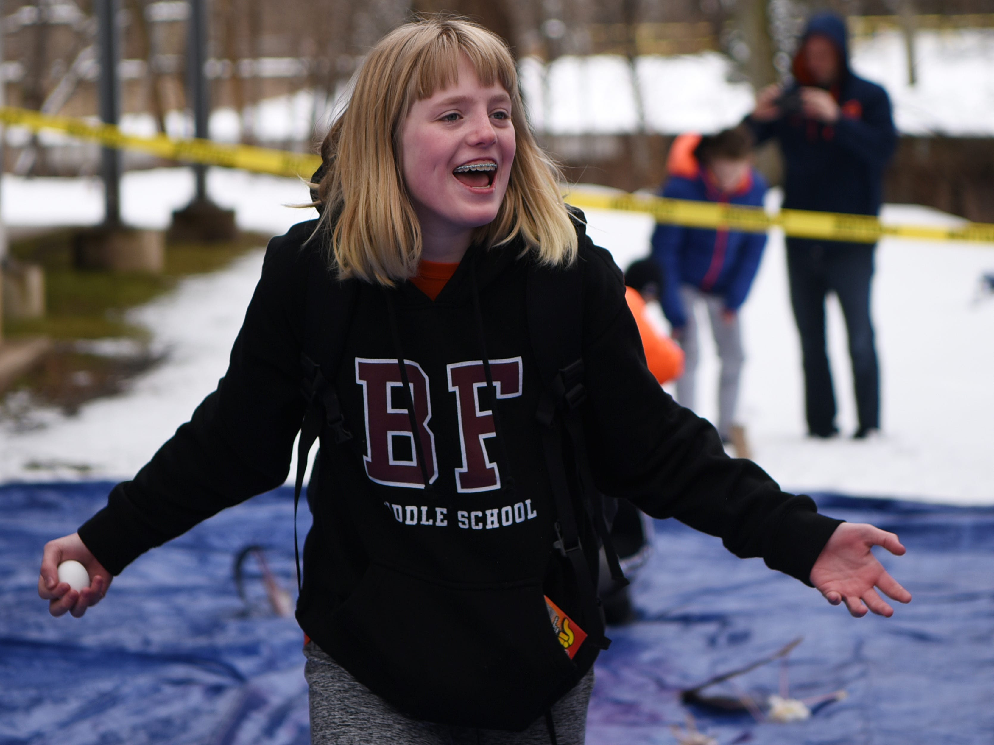 Ella Sands, 12,  reacts after her egg lands safely during the Egg Drop. Children must create a device that will prevent their egg from breaking from a 30 foot drop. This is one of many hands on activities during Super Science Saturday held at Ridgewood High School in Ridgewood on Saturday March 2, 2019.